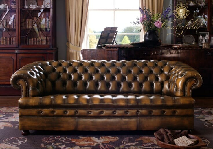 A chesterfield sofa with buttons on seats