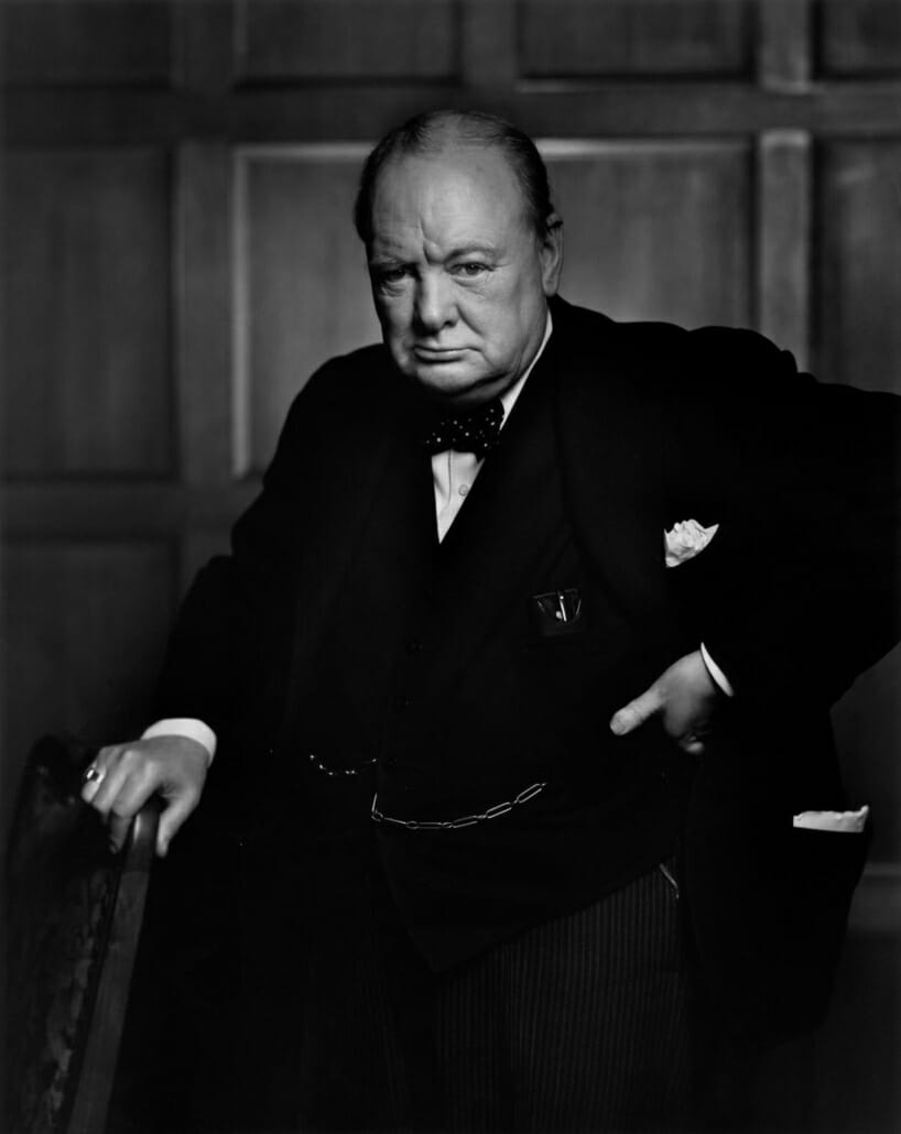 Winston Churchill wearing his signature polka dot bow tie in an iconic photograph by Yousuf Karsh
