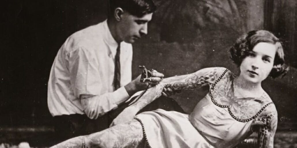 A woman being inked