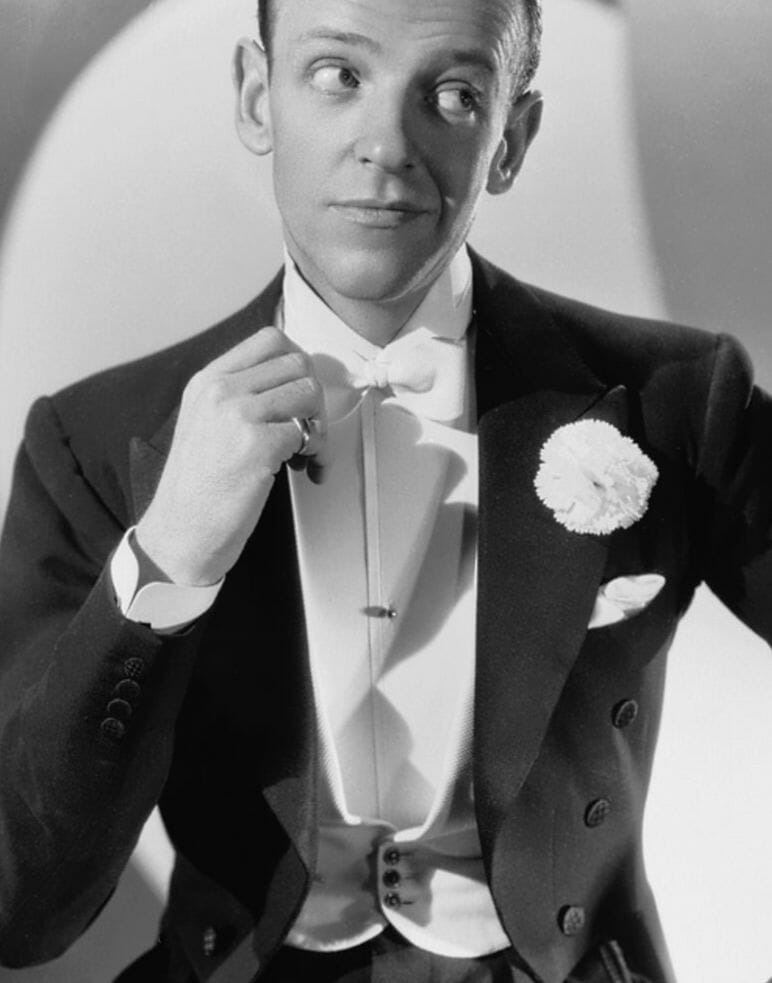 Fred Astaire circa 1936 wearing the popular white pearl shirt stud and the periods novel black waistcoat studs.