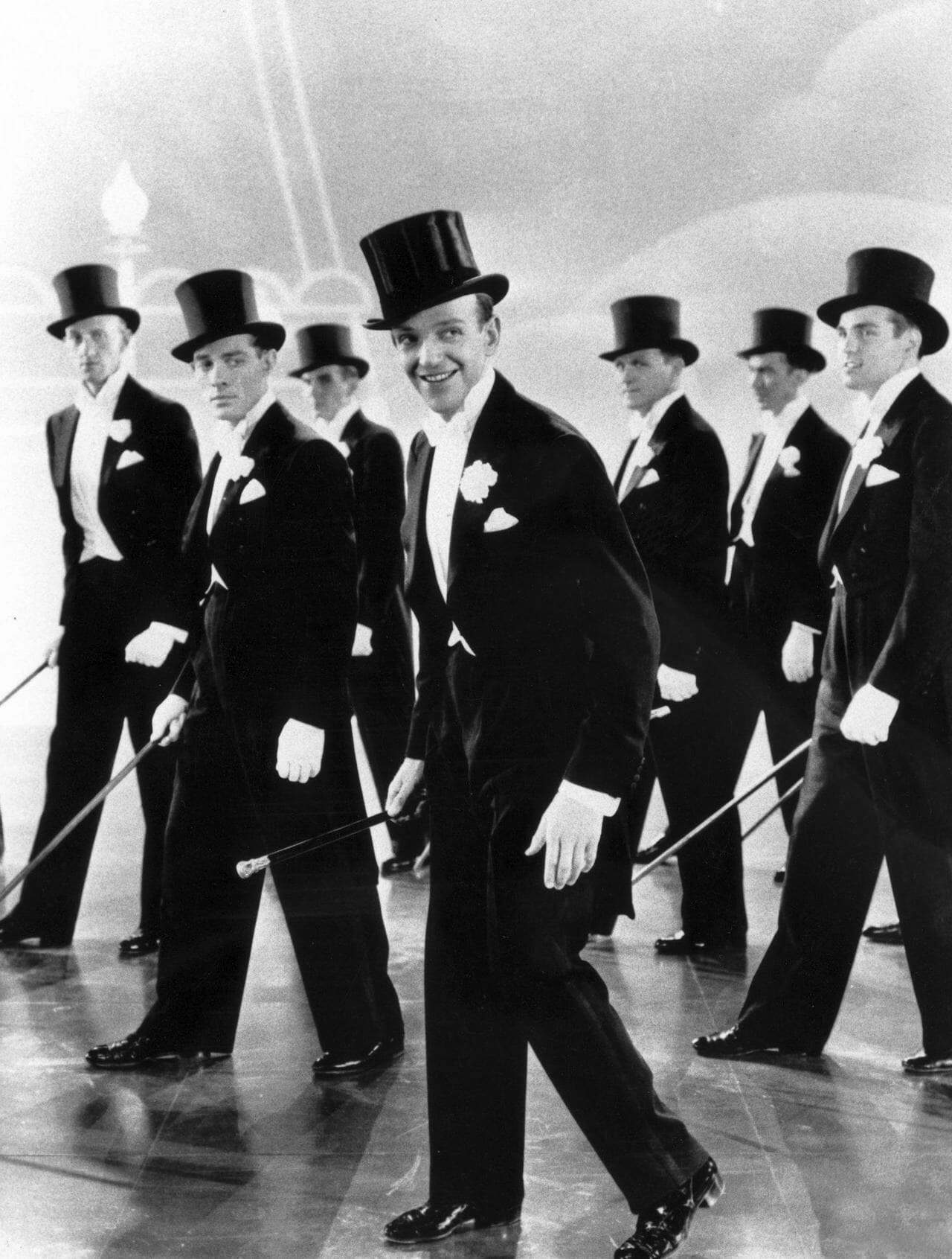 Fred Astaire dancing in white tie