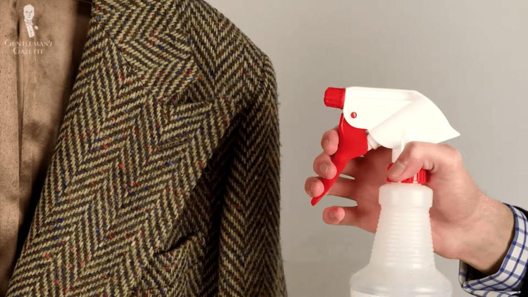 Directly spraying vodka onto a smelly overcoat