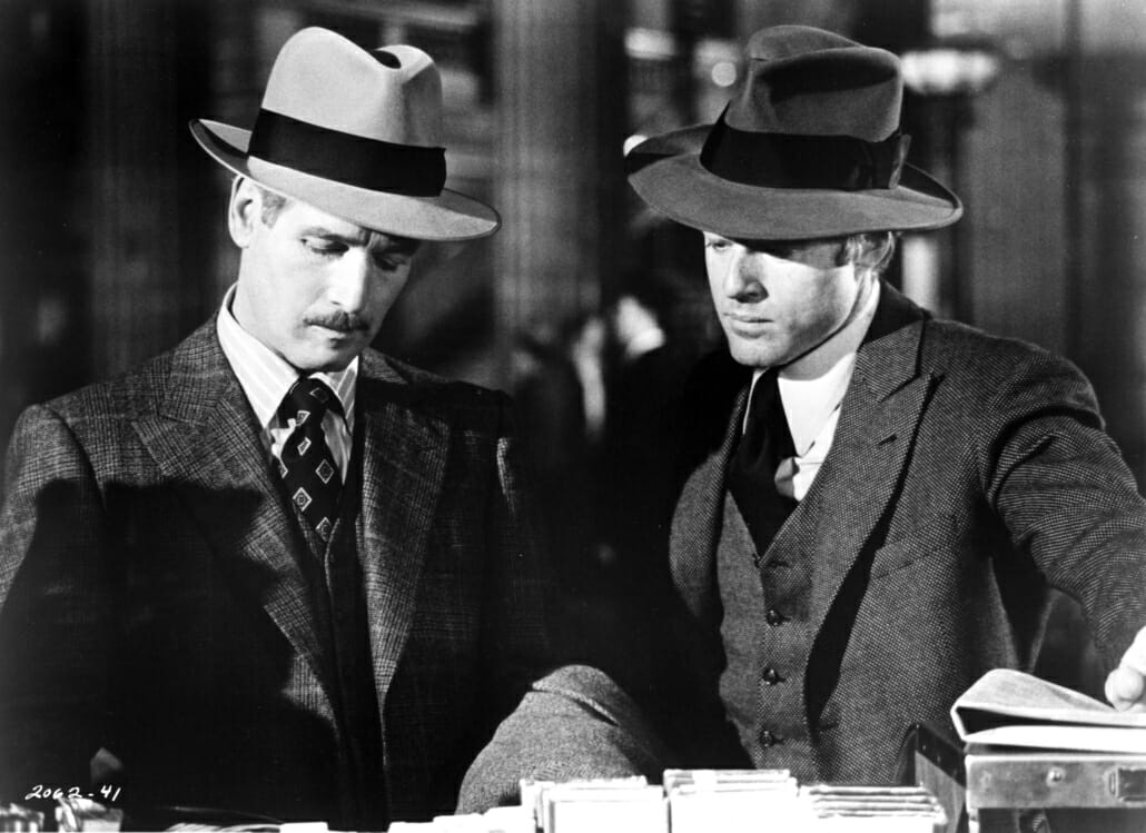 Paul Newman (L) and Robert Redford in 1973's The Sting. Note the 1930's costumes, including fedoras and suits with checks and patterns.
