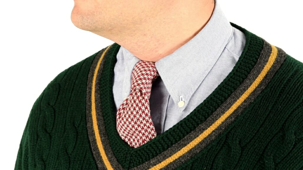 OCBD collar shirt with a green tennis sweater and a houndstooth tie