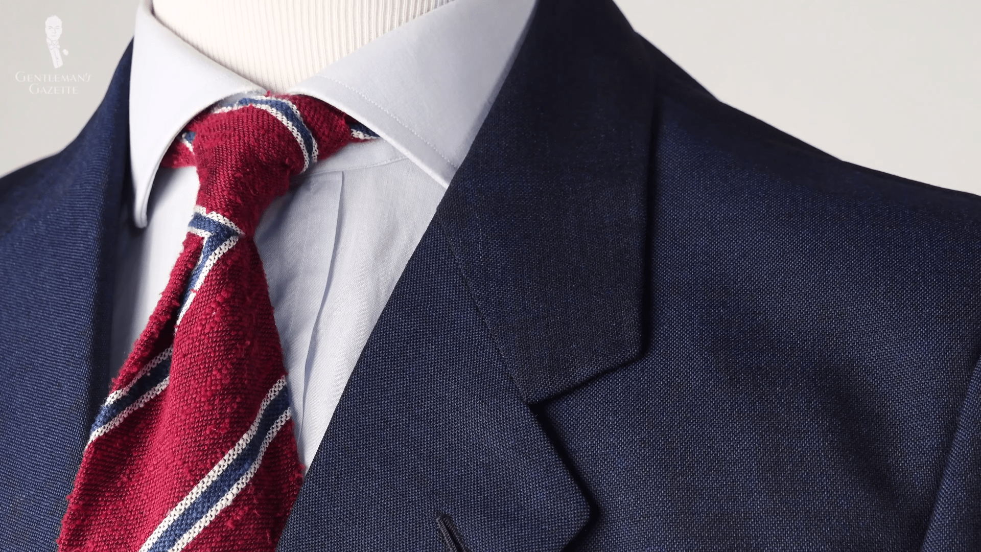 A blue jacket, pale blue shirt, and shantung striped tie in red, blue, and white