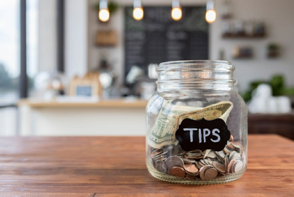 Tip Jar with coins and dollars