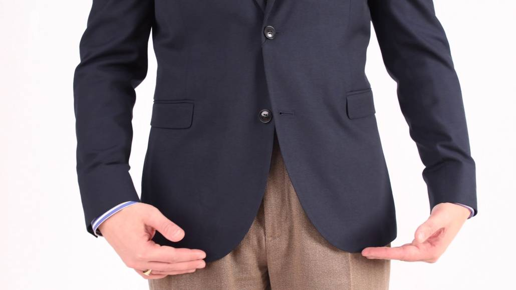 A navy jacket with rounded quarters.