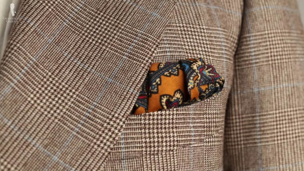 Antique Gold Yellow Silk Wool Pocket Square with Paisley paired with a Prince of Wales check jacket