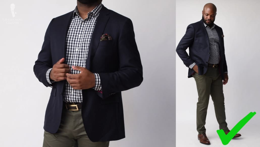 Kyle wears a navy jacket with a white and blue dress, a moss green silk wool pocket square from Fort Belvedere accented over his green pants.