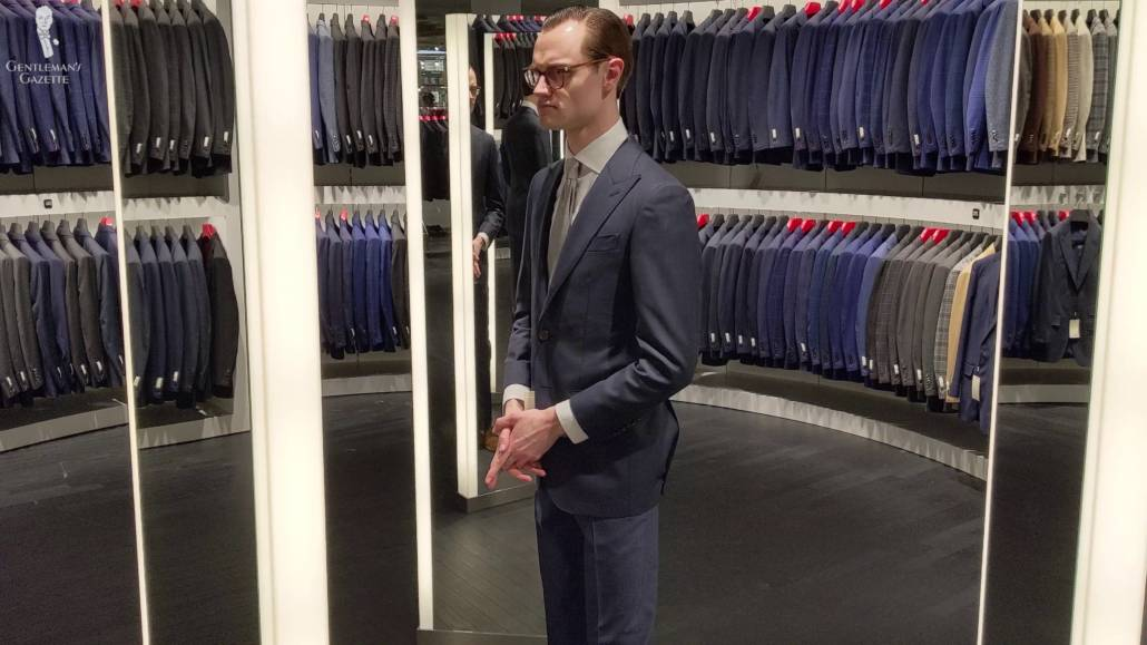 Preston trying on some suits.