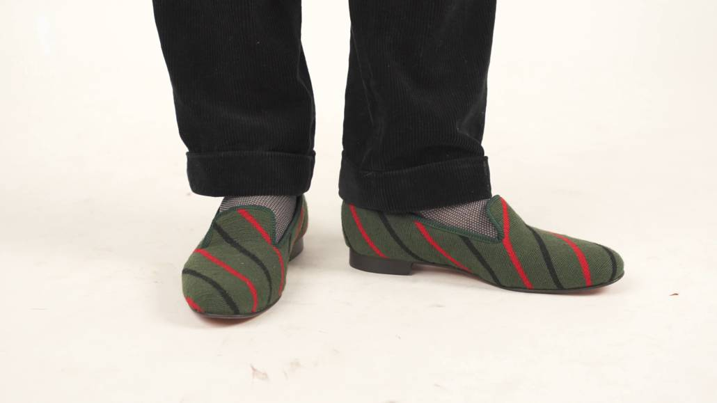 Albert Slippers in needlepoint green with red and black stripes.