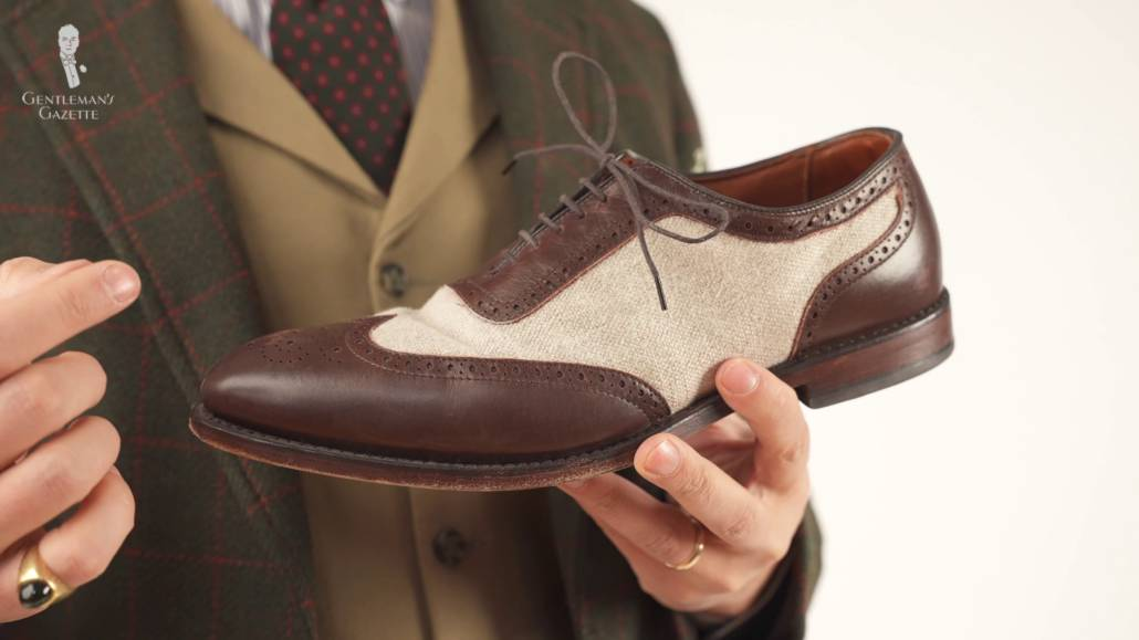 Brown and white spectator shoes.