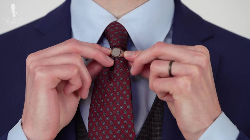 Preston wearing a signet ring on his tie.