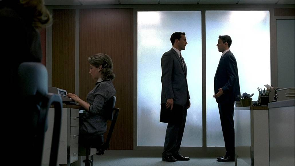 Don Draper and Peter Campbell having a conversation; Both are wearing a business suit.