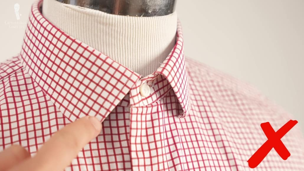 A curled collar tips is a hallmark of a cheaply or not thoughtfully-made shirt collar.