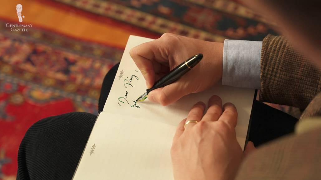 Raphael writing on his journal