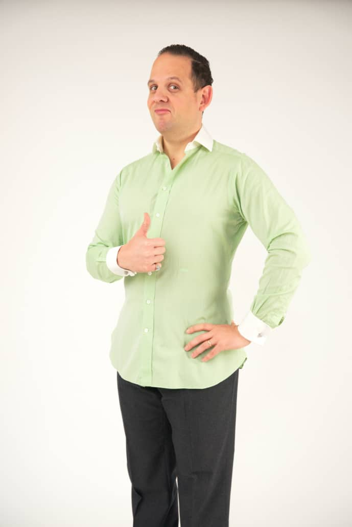 Raphael giving a thumbs up for his outfit; he's wearing a light green bespoke shirt with white French cuffs and white Winchester clubcollars.
