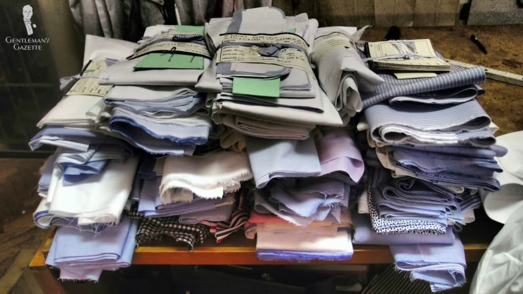 A pile of fabric used for bespoke shirts