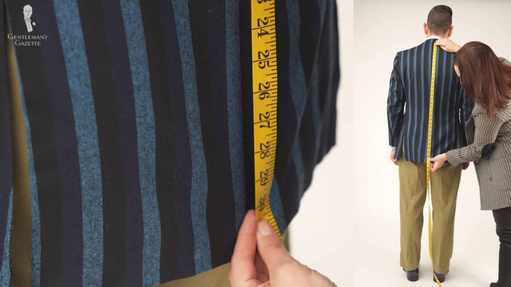 Raphael getting his jacket patterned jacket's length measured by Teresa