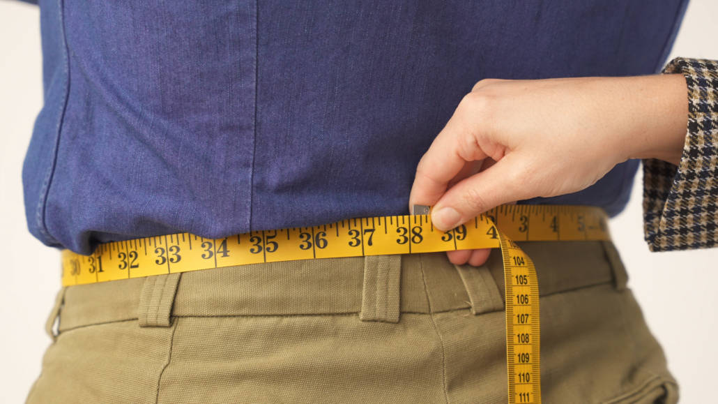 Teresa measuring Raphael's waist size