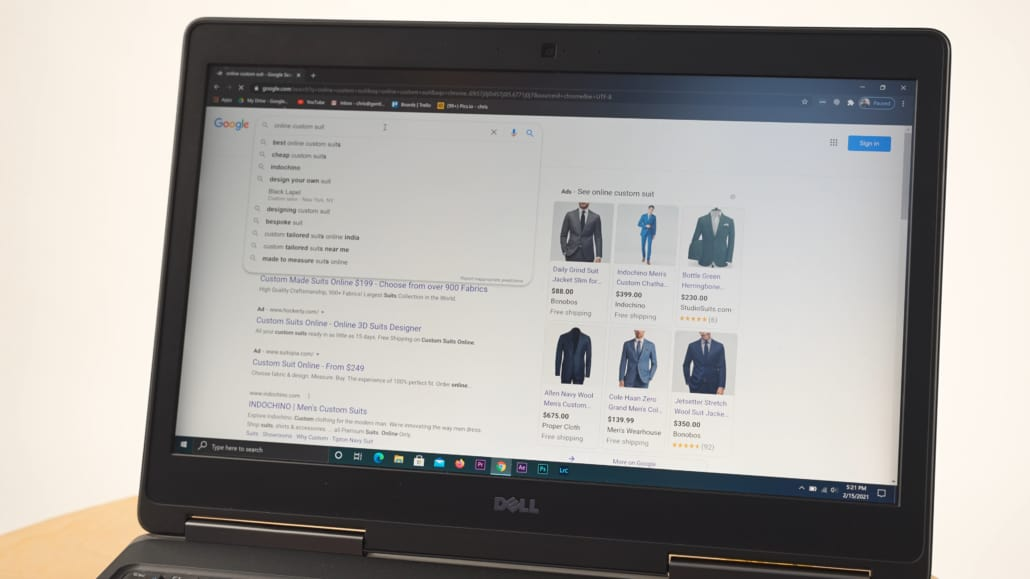 Googling good sites for buying suits online using a laptop