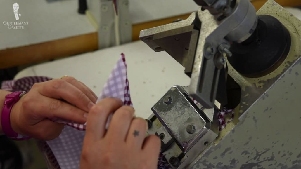 A shirt being sewn together using a machine.