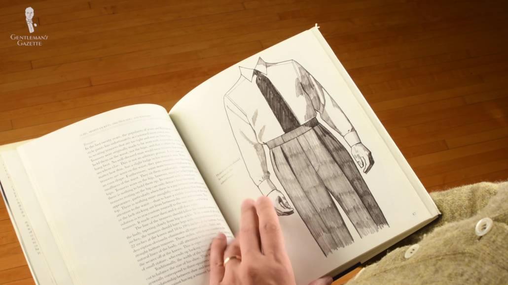 Raphael reading a classic menswear book